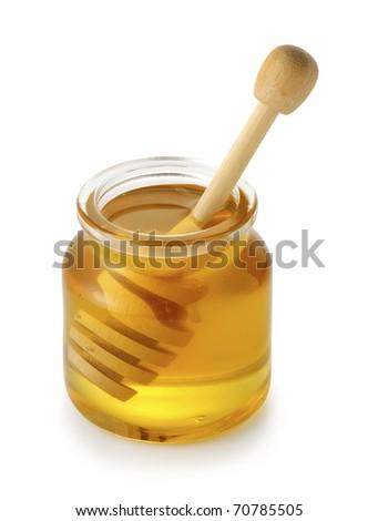 Honey bottle with stick. - stock photo