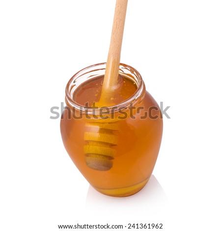 Honey dipper in jar - stock photo