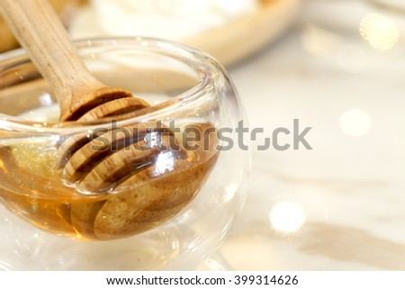 Honey dipper, over light  [blur and select focus background] - stock photo