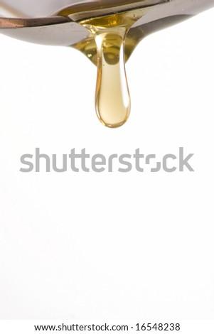 Honey drip from spoon - stock photo