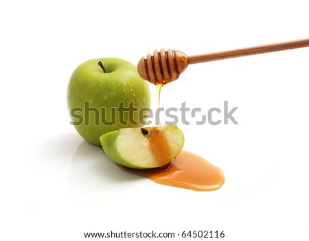 Honey dripping on a green apple slice.