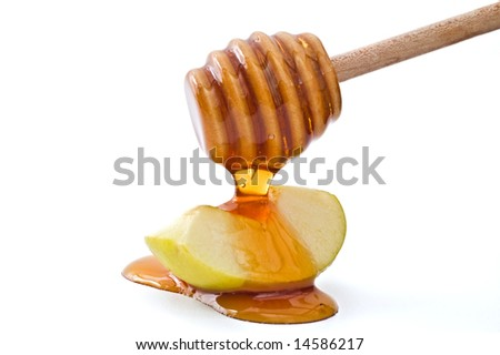 Honey dripping on a green apple slice isolated on white - stock photo