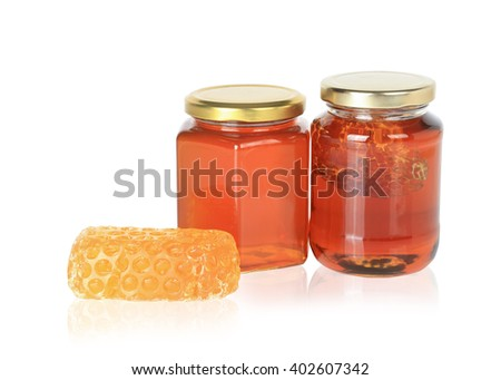 Honey from nature pollen flower in glass bottle and honey soap  isolated on white background. This has clipping path.  - stock photo