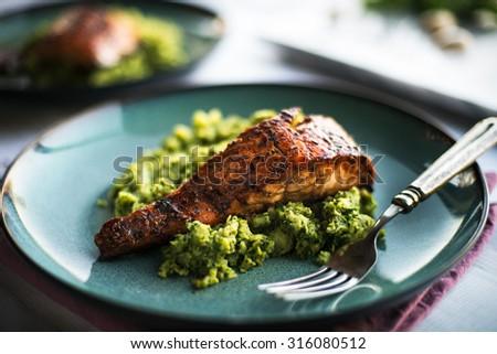 Honey glazed salmon Filet on a bed of vegetables - stock photo