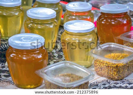honey, honeycombs, and honey products in the middle of the summer