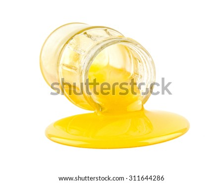 honey in a jar isolated on a white background - stock photo