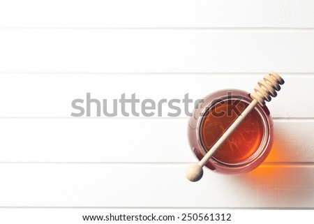 honey in a jar on kitchen table
