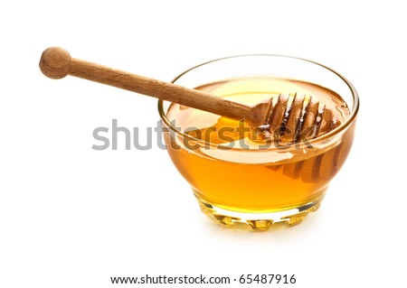 honey in glass jar isolated - stock photo
