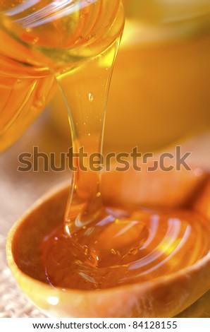 honey in spoon - stock photo