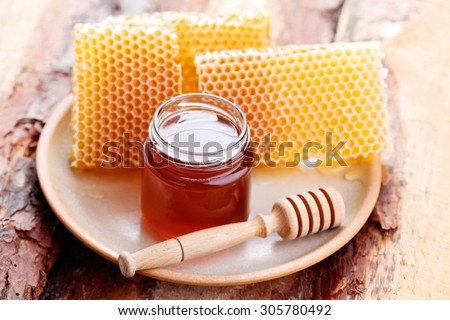 honey in the jar with honeycomb - sweet food - stock photo