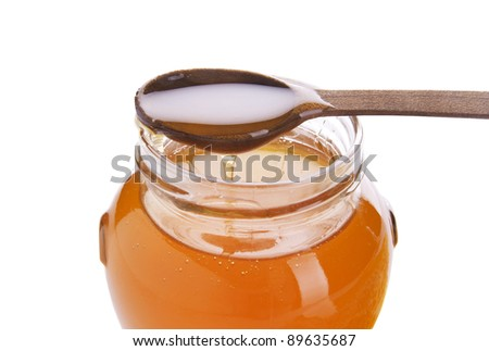 Honey in the pot isolated  on a white background