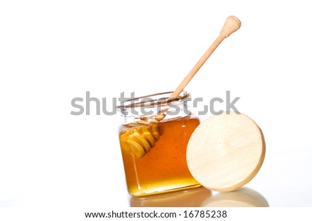 Honey jar - stock photo
