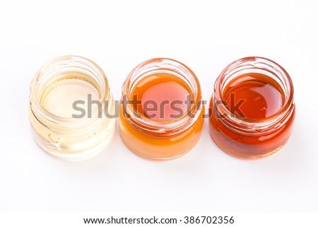 honey jar on white background , healthy food - stock photo