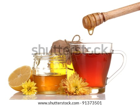 honey, lemon and a cup of tea isolated on white - stock photo