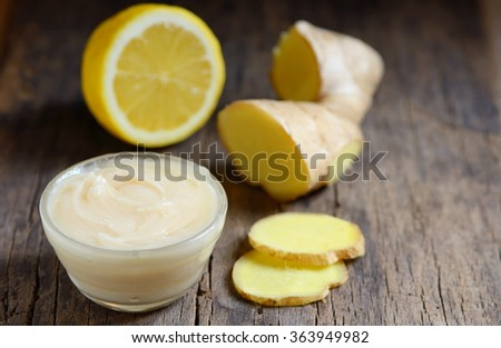 honey, lemon and ginger on a wooden background