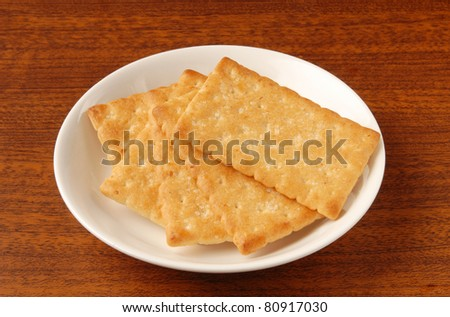 Honey-oats coconut biscuit on a white plate - stock photo