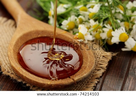 Honey on a wooden table