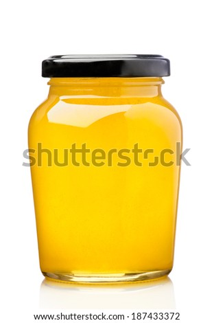 Honey pot preserved, isolated on white - stock photo