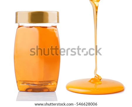 Honey pouring and honey bottle isolated on white background