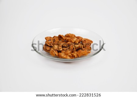 honey roasted peanuts Isolated On White. - stock photo