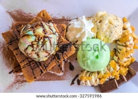 honey toast with fruit and ice cream on bread. - stock photo