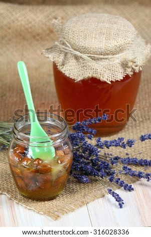 Honey with almonds and lavender - stock photo