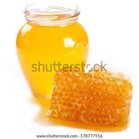 honey with honeycomb isolated on white background - stock photo