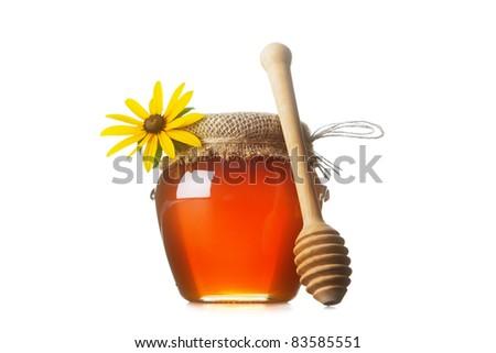Honey with wood stick - stock photo
