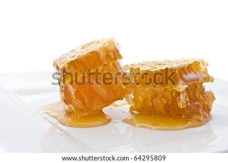 Honeycomb on white - stock photo