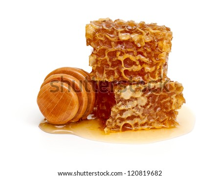 honeycombs and honey dipper over white - stock photo
