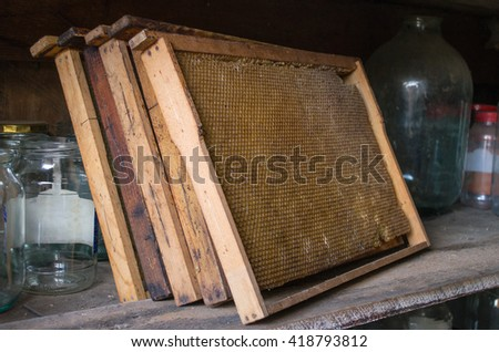 honeycombs for honey on the old shelf - stock photo