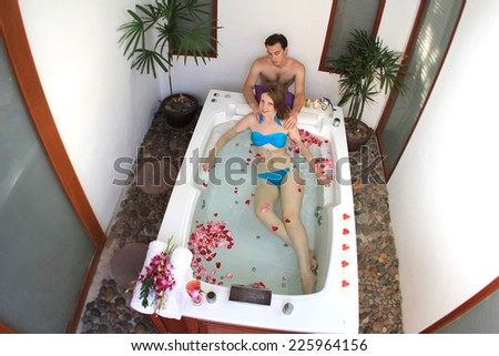 Honeymoon in jakuzzi  on tropical island, Thailand - stock photo