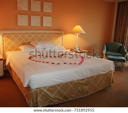 Honeymoon Suite In A Modern Hotel Room With King Sized Bed And Flowers Formed Into
