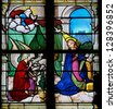 HONFLEUR - FEBRUARY 11: The Annunciation on a stained glass window in Saint Catherines church in Honfleur, Calvados, France on February 11, 2013. - stock photo