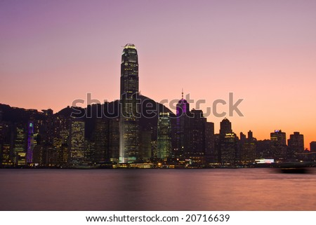 Hong Kond Island skyline at dusk with a red and purple sunset - stock photo