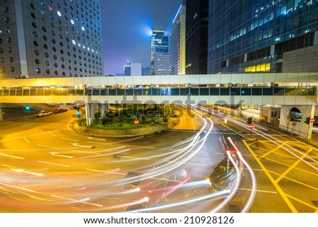 HONG KONG - APRIL 14, 2014: Classic red taxis in downtown at night. More than 90 percent of population use the efficient public transportation system. - stock photo