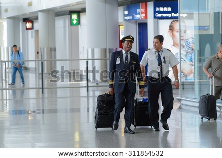 HONG KONG - APRIL 15, 2015: pilots of United Airlines after flight. United Airlines, Inc. is an American major airline headquartered in Chicago, Illinois - stock photo