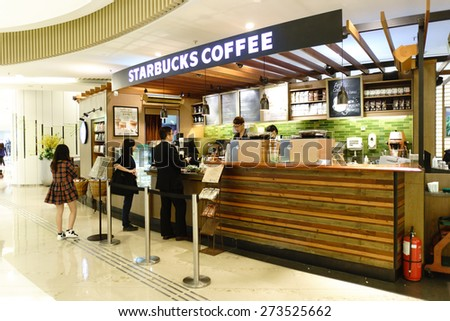 HONG KONG - APRIL 16, 2015: Starbucks Cafe in shopping mall. Starbucks Corporation is an American global coffee company and coffeehouse chain based in Seattle, Washington  - stock photo