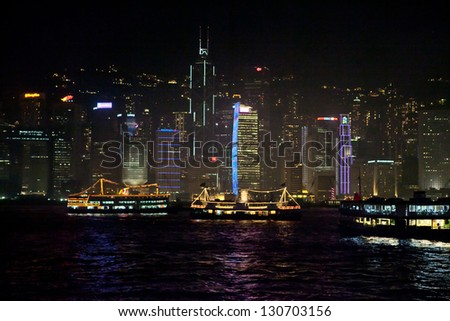 HONG KONG - APRIL 10: Victoria Harbor in Hong Kong April 10 2011. The Victoria Harbour is world-famous for its stunning panoramic night view and skyline - stock photo