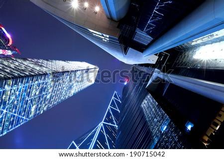 Hong Kong at night, view from below - stock photo