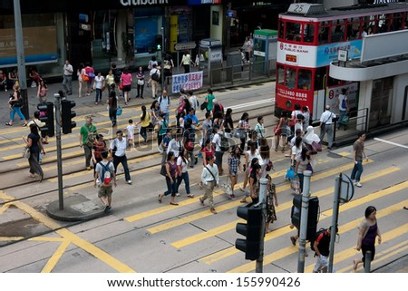 HONG KONG - AUG 31: Central District and city life of Hong Kong on Aug 31 2013. Hong Kong is one of the most densely populated areas and the world's leading international financial centres. - stock photo