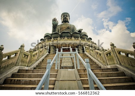 HONG KONG - AUGUST 29: Tian Tan Buddha on Lantau Island in Hong Kong on August 29, 2013. It is 34 meters tall and is a major centre of Buddhism in Hong Kong, it is also a popular tourist attraction - stock photo