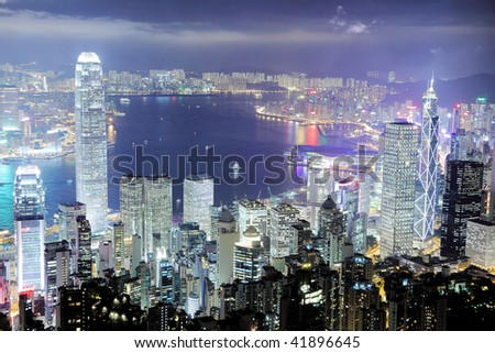 Hong Kong central district skyline and Victoria Harbour view at night. - stock photo