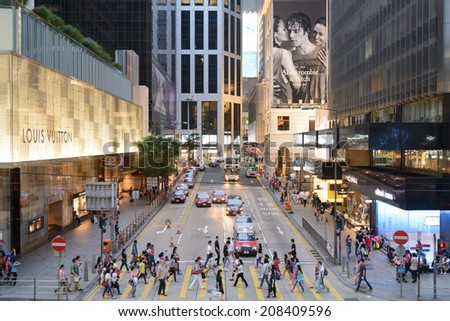 HONG KONG, CHINA - APR 27: Crowded street view on April 27, 2014 in Hong Kong, China. With 7M population and land mass of 1104 sq km, it is one of the most dense areas in the world. - stock photo
