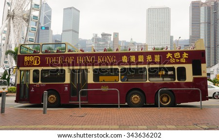 HONG KONG, CHINA - APR 23, 2015. Double-deck tourist bus running in Hong Kong, China. The Double-deck trams system in Hong Kong is one of three and the most famous in the world. - stock photo
