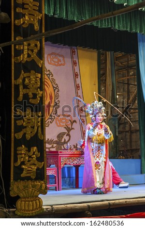 "HONG KONG,CHINA - AUG. 27:""Xiqu"" , Chinese Opera was performed on Aug 27, 2013 in Hong Kong to celebrate ""Yu Lan"", The Hungry Ghost Festival. It is linked to the Chinese practice of ancestor worship."