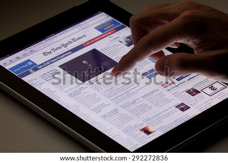 Hong Kong, China - August 7, 2011: Image of browsing the New York Times website using an ipad. The New York Times is a popular American daily newspaper and its website is the most popular American - stock photo