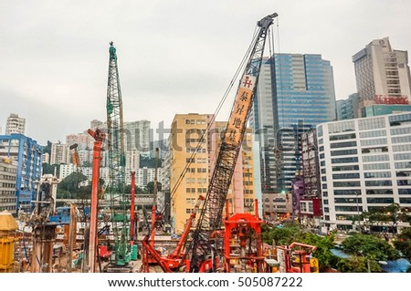 Hong Kong, China - 29 AUGUST, 2016: Industrial with working crane bridge, backhoe work in construction site  in Hong Kong