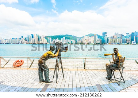 HONG KONG, CHINA - August 14: Statue and skyline in Avenue of Stars on August 14 2014 in Hong Kong, China. The promenade honours celebrities of the Hong Kong film industry as the famous attraction. - stock photo