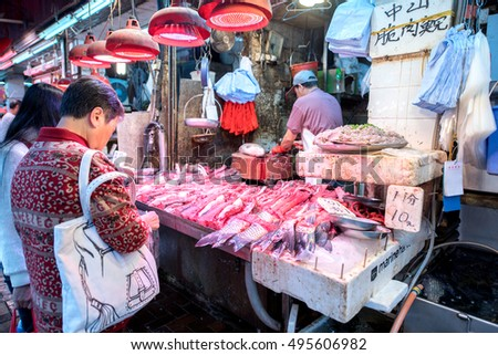 HONG KONG, CHINA - DECEMBER 7, 2015: Fish market spread seafood for sale on a street on DECEMBER 7, 2015